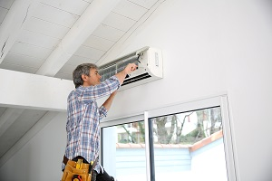 Aircon Service Technician dismantling aircon parts for cleaning